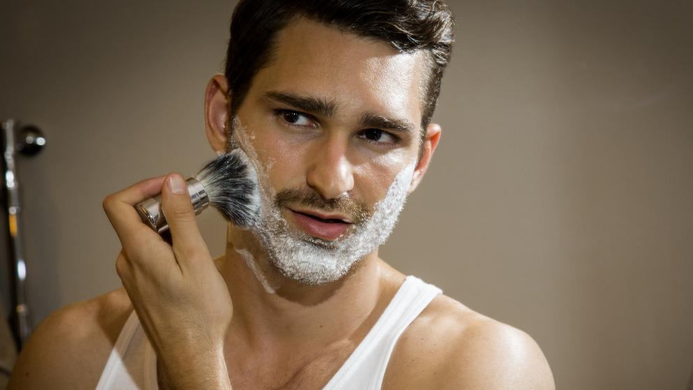Man applying Weleda Shaving Cream with brush